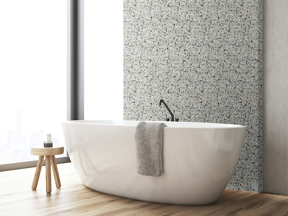 Corner of a bathroom with bathtub and a small wooden chair
